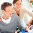 Young couple with their cute newborn baby - Foto Stock