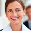 Closeup portrait of young business woman with colleague at the b - Stock Photo