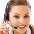 Closeup of a smiling receptionist isolated over white background - Stok fotoğraf
