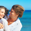 Royalty-Free Stock Photo: Portrait on the beach where the guy taking girl in his arms