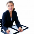 Confident businesswoman in suit working and smiling towards the - Stock Photo