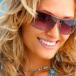 Royalty-Free Stock Photo: A girl smiling wearing sunglasses