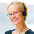 A business woman wearing glasses and headphones - Stock Photo