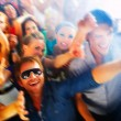 A group of young enjoying a concert - Stock Photo