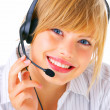 A smiling young blond wearing headset over white background - Stock Photo