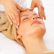 Woman receiving head massage - Stock Photo