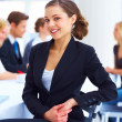 Royalty-Free Stock Photo: Confident young beautiful business woman in a meeting