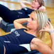 Young pretty women exercising in a fitness center - Stock Photo