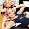 Pretty women exercising in a fitness center - Stok fotoğraf