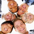 Royalty-Free Stock Photo: Group of business standing in huddle, smiling, low angle