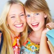 Royalty-Free Stock Photo: Two attractive happy girls out shopping