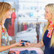 A buyer and a shop assistant looking at each other with smiles b - Stock Photo