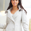 Portrait of smart young lady wearing a coat - Stock Photo