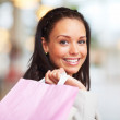 Closeup portrait of joyful young lady carrying shopping bags - Stock Photo
