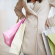 Closeup portrait of midsection of lady with shopping bags - Стоковая фотография