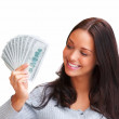Portrait of young female holding money in the hand on white back - Stock Photo