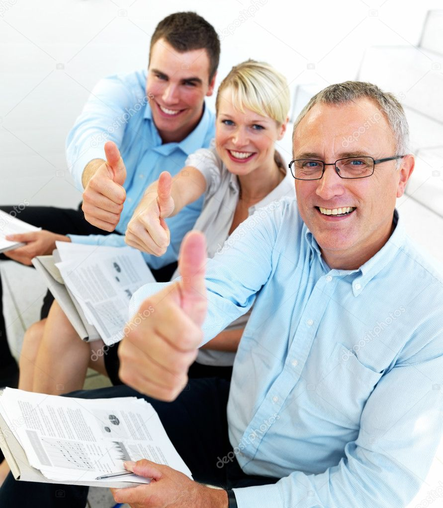 Proud business team giving the thumbs up — Stock Photo #3291008