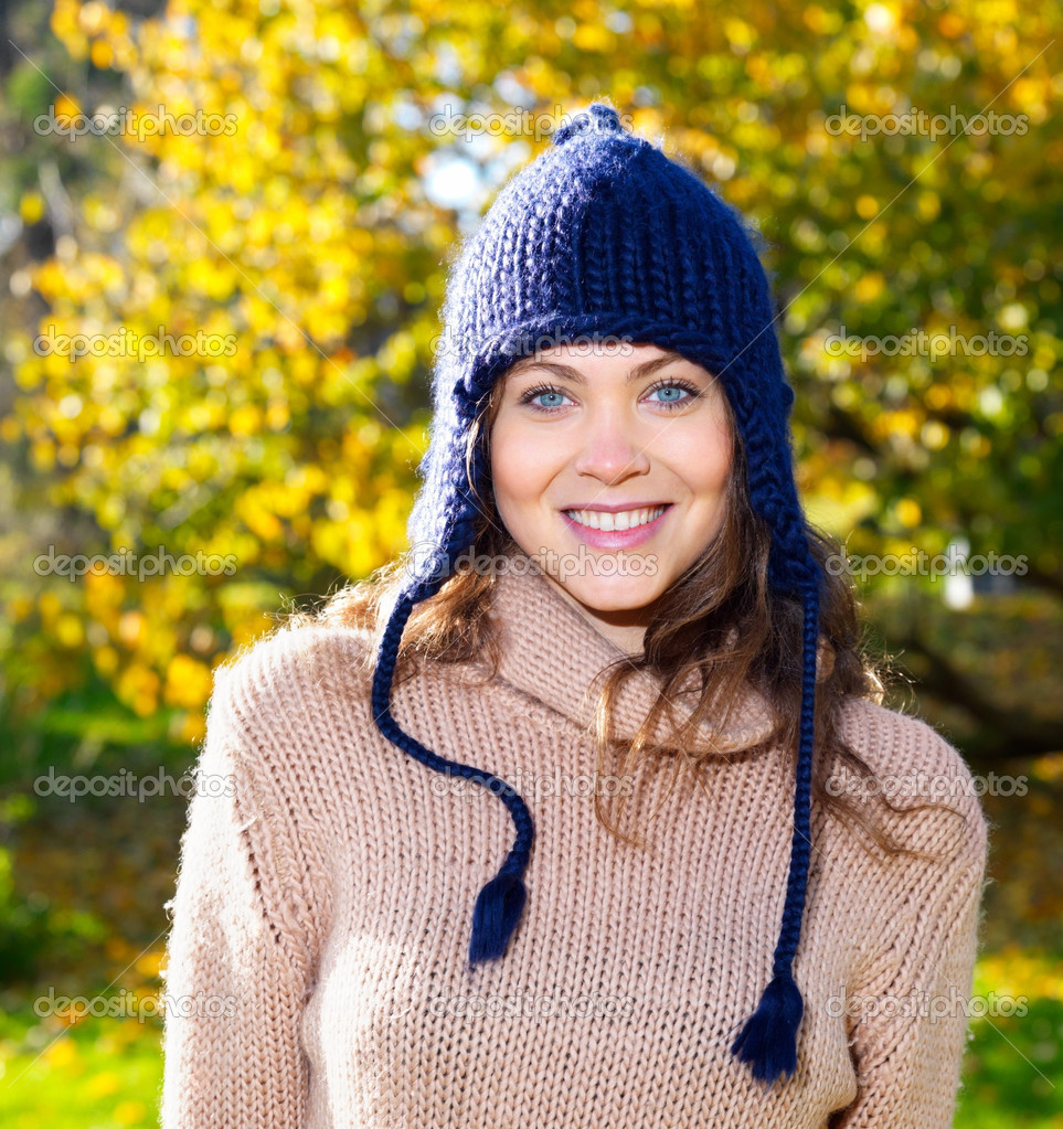 Closeup portrait of a beautiful young woman with trees in background — Stock Photo #3291254
