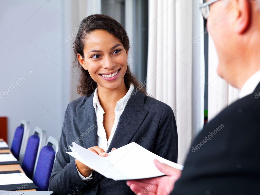 Portrait of business man and woman passing paperwork — Stock Photo #3291861
