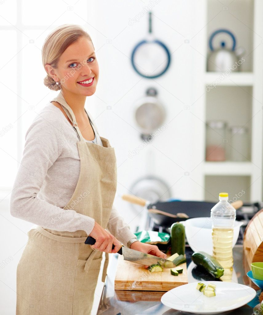 Young beautiful woman cutting vegetables in kitchen  Stock Photo #3292098