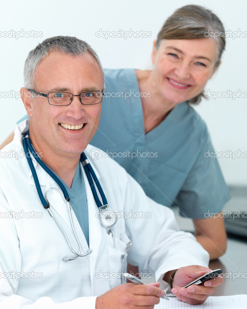 Happy Mature doctor and nurse ready to help you — Stockfoto #3292415