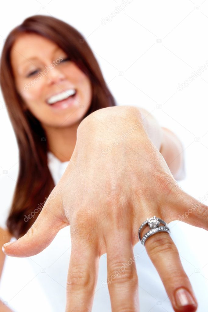 Young beautiful woman showing her engagement ring — Stock Photo #3292655