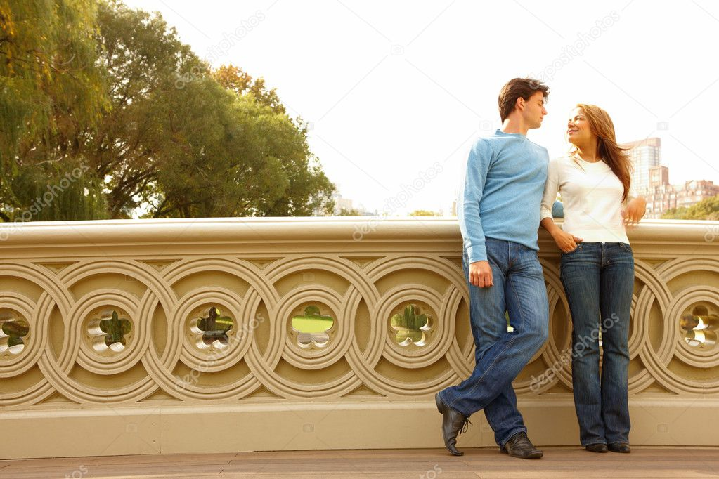 Romantic couple  standing on bridge — Stock Photo #3292716