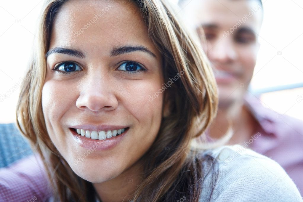 Smiling woman with man in  background — Photo #3292818