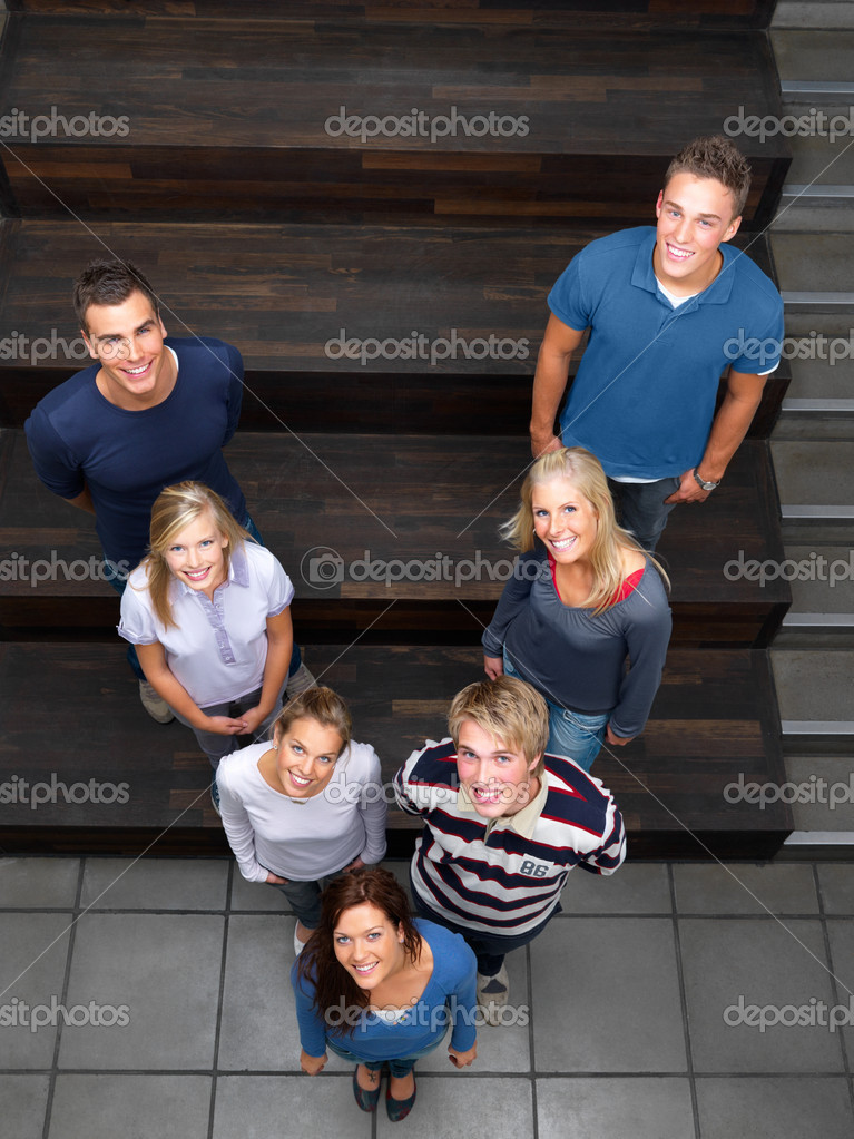 Group of students standing in v — Stock Photo #3292946