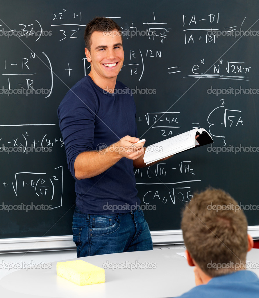 Teacher teaching  mathematics in classroom  Stock Photo #3292961