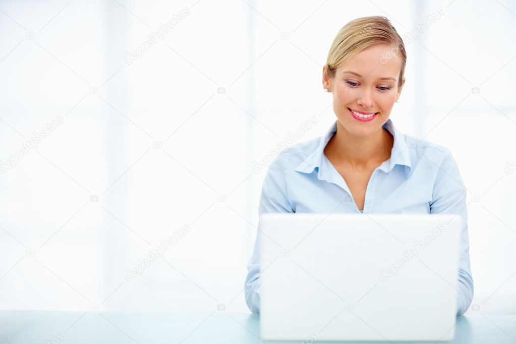 Young smiling business person using laptop beside copyspace — Stock Photo #3293886
