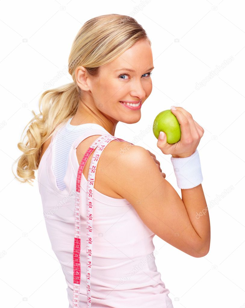 Rear view of a young smiling woman turning back holding apple and measuring tape over white background — Stock Photo #3294214