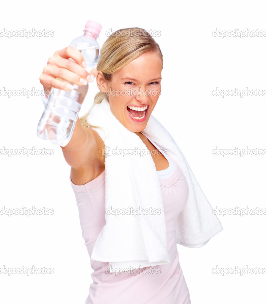 Young hyper active woman holding the bottle of water over white background — Stockfoto #3294246