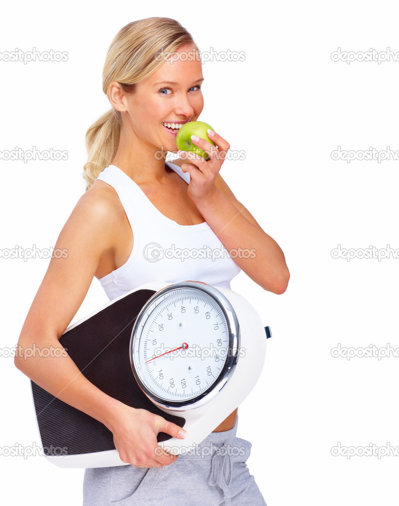 Young healthy woman eating apple and carrying a weight scale over white background — Stockfoto #3294305