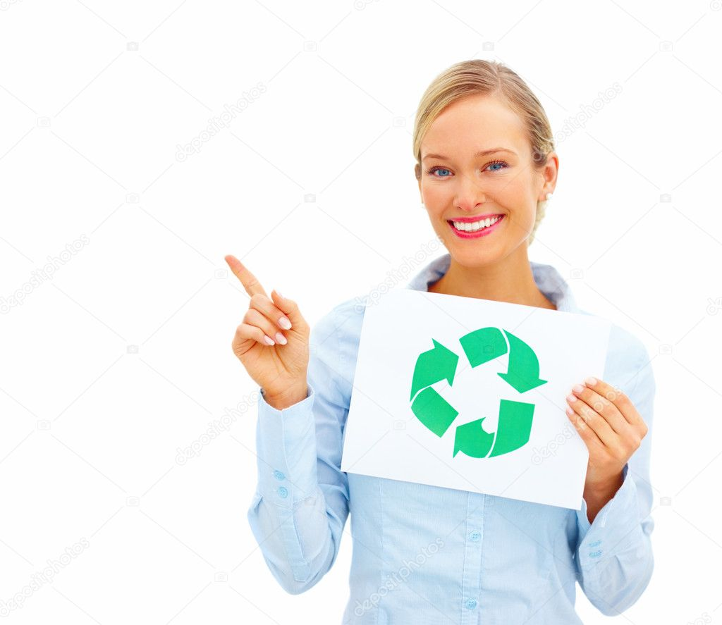 Young businesswoman pointing away and holding a recycle symbol over white background  Stock Photo #3294443