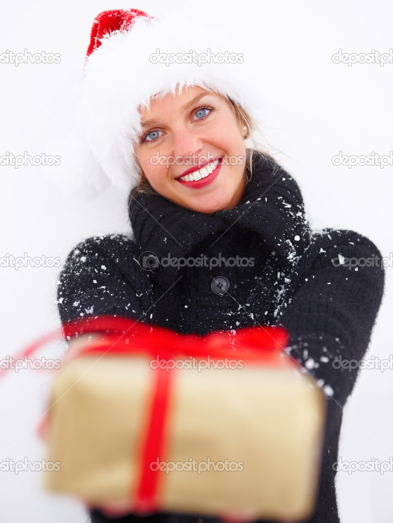 Girl in black woollen coat handing over a Christmas gift isolated on white background — Stok fotoğraf #3294803