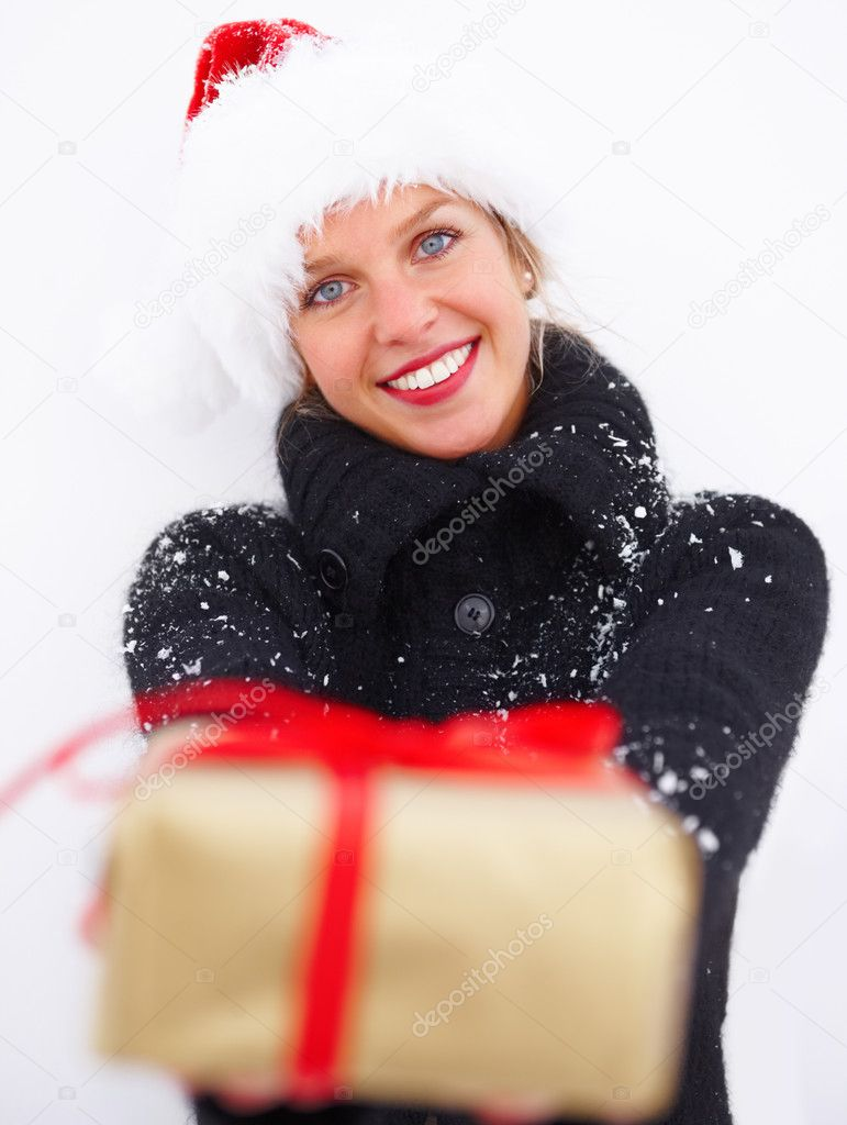 Girl in black woollen coat handing over a Christmas gift isolated on white background — Lizenzfreies Foto #3294803