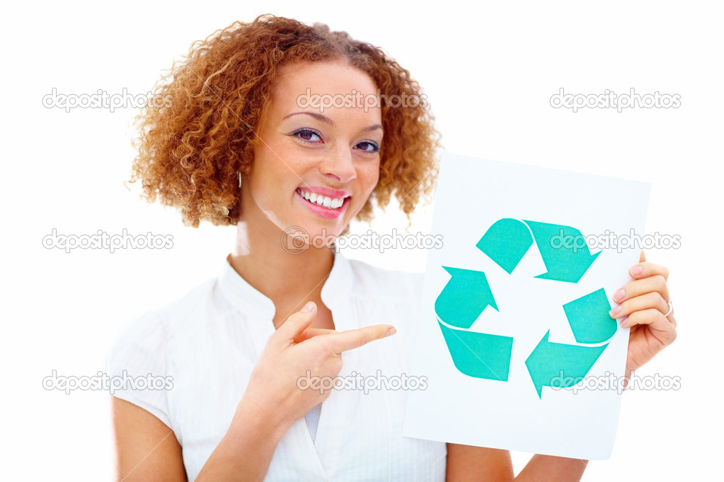 Environmentally friendly woman pointing a paper board with recycle symbol — Stock Photo #3295197