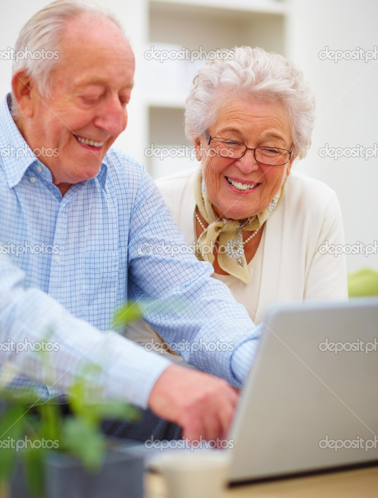 depositphotos 3295479 Closeup of a mature couple using a laptop Old couple working together on computer stock photo, Senior man and woman ...