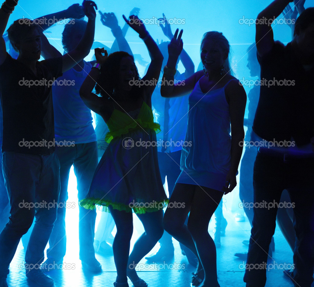 Group of young boys and girls dancing at nightclub  Stock Photo #3295818