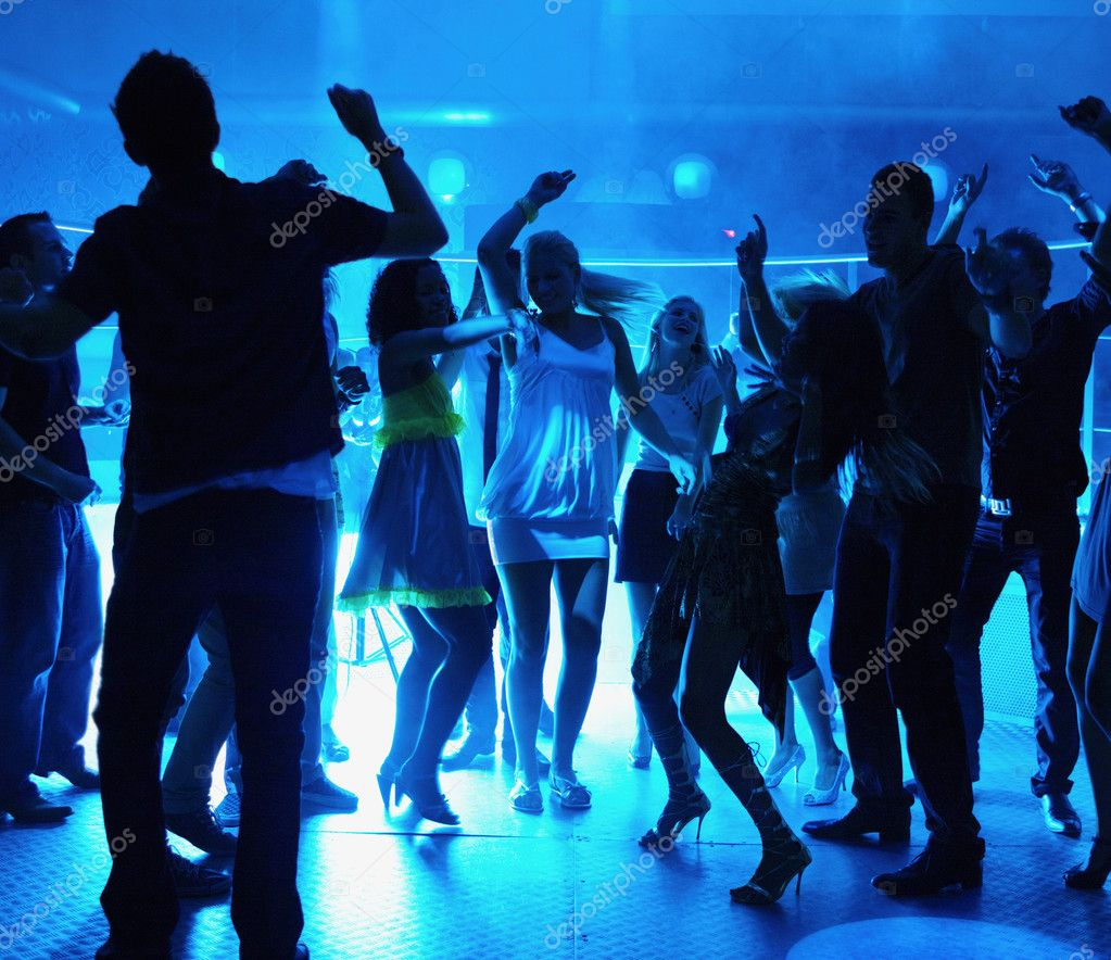 Silhouette of men and women dancing at a disco — Stock Photo #3296009