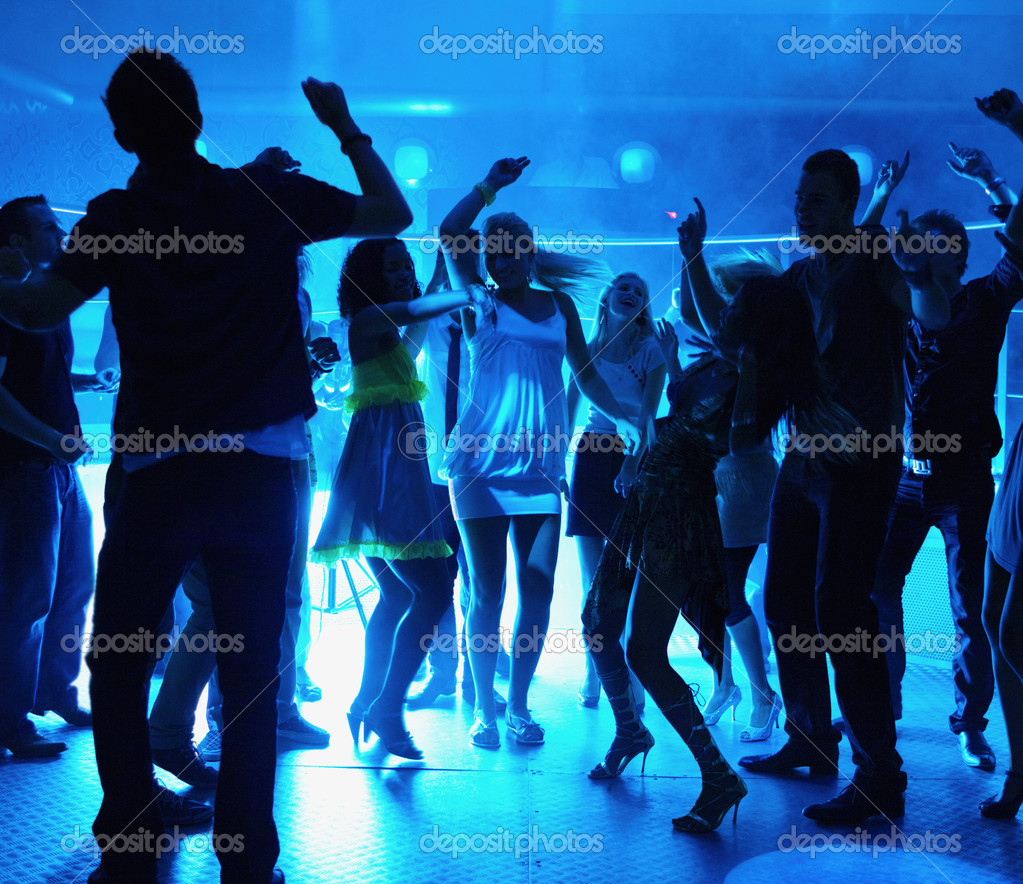 Silhouette of men and women dancing at a disco — Foto Stock #3296009