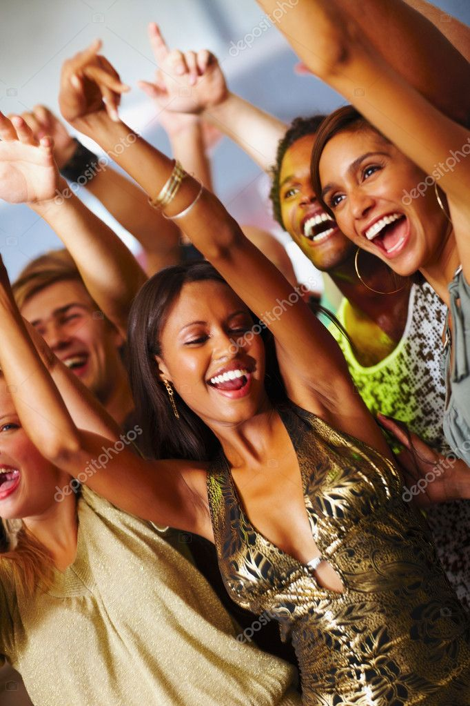 Happy young boys and girls enjoying at a disco — Stock Photo #3296051