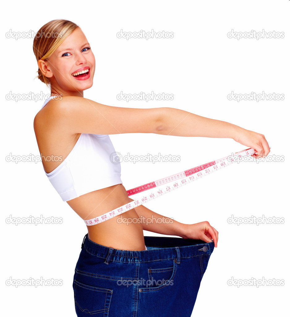 Happy young woman in old jeans pant after losing weight — Photo #3297903