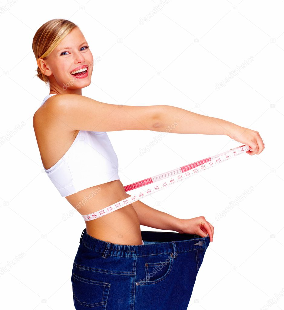 Happy young woman in old jeans pant after losing weight — Foto de Stock   #3297903