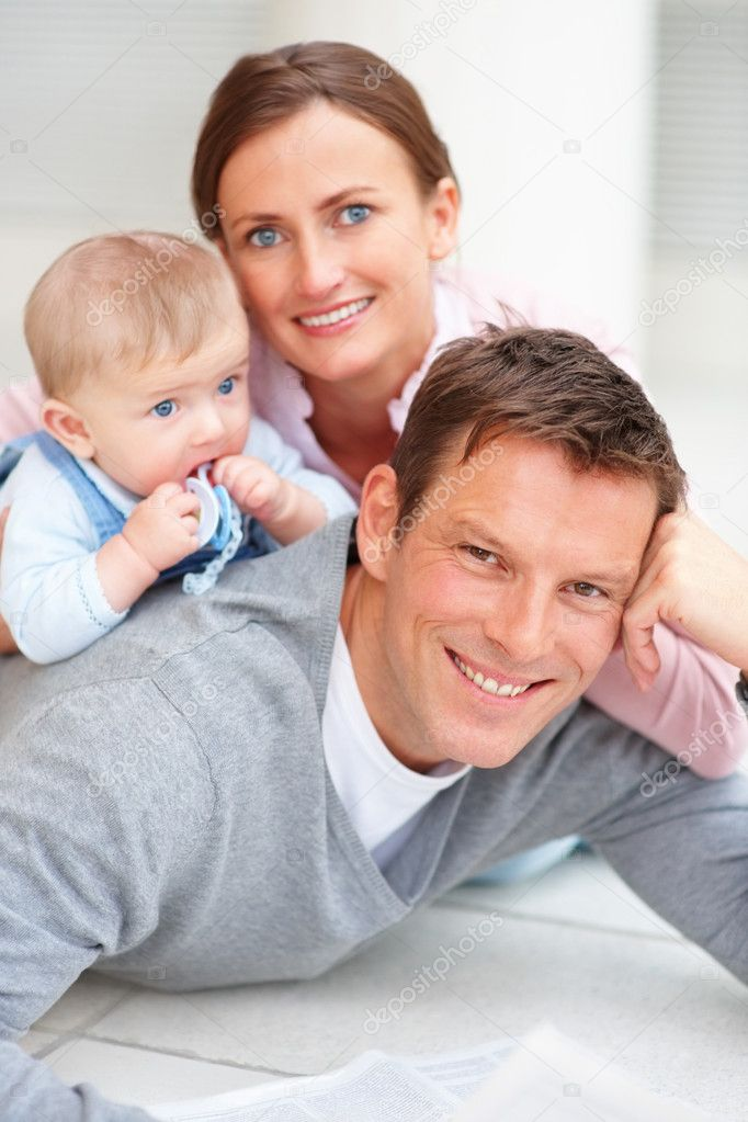 Portrait of a happy young couple with their adorable newborn baby — Stock Photo #3298173