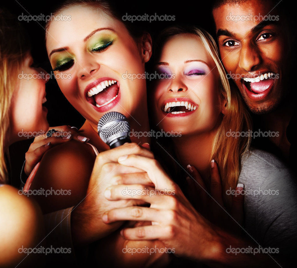 Closeup of a group of happy young singing — Stock Photo #3299334
