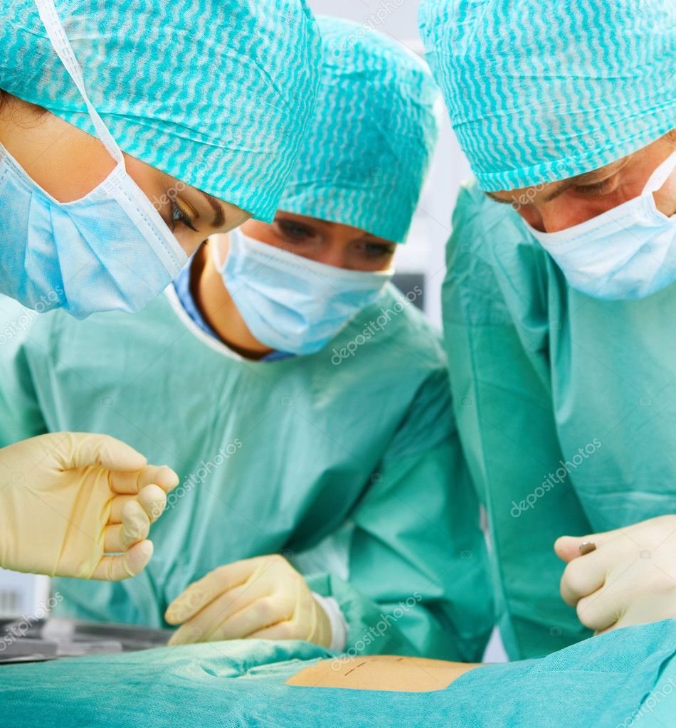 Closeup of a medical team performing an operation — Stock Photo #3299454