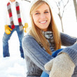 Royalty-Free Stock Photo: Pretty young female sitting outside on snow with her boyfriend s