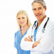 Royalty-Free Stock Photo: Successful doctor with hands folded and a female colleague at th